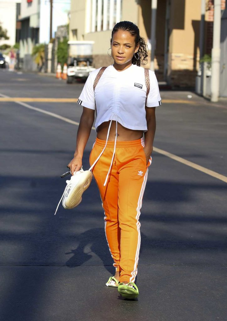 Christina Milian in an Orange Adidas Track Pants
