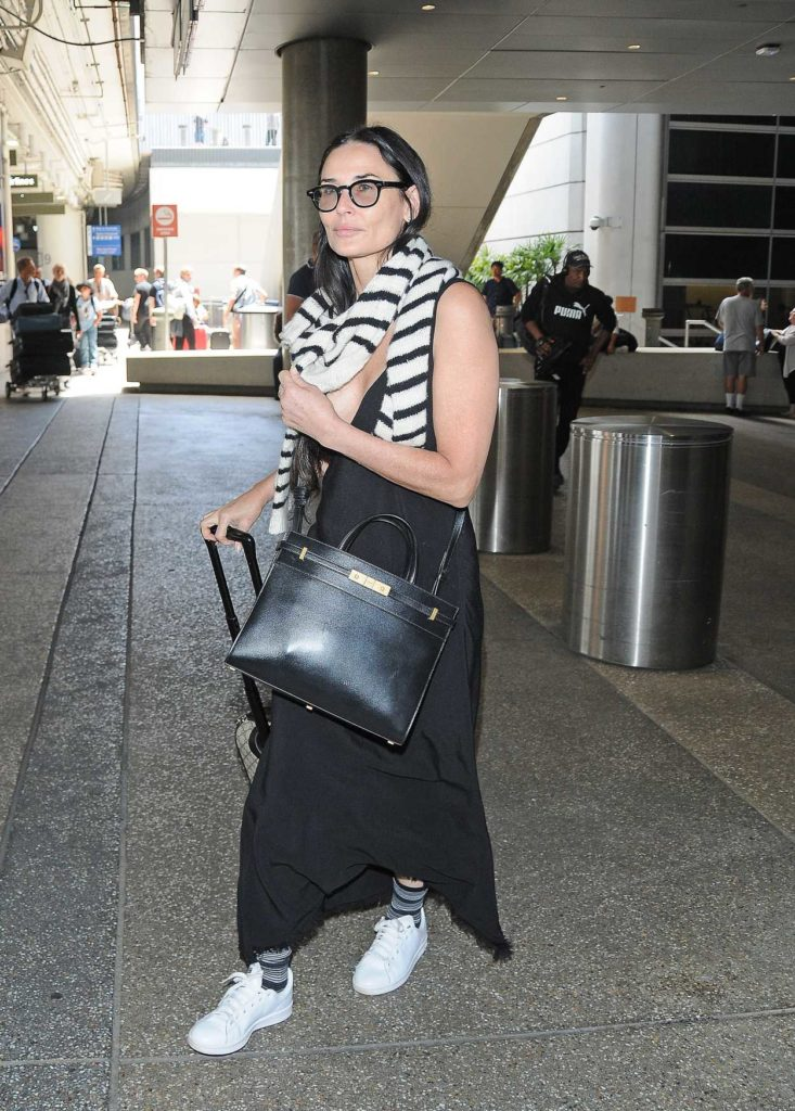 Demi Moore in a White Sneakers