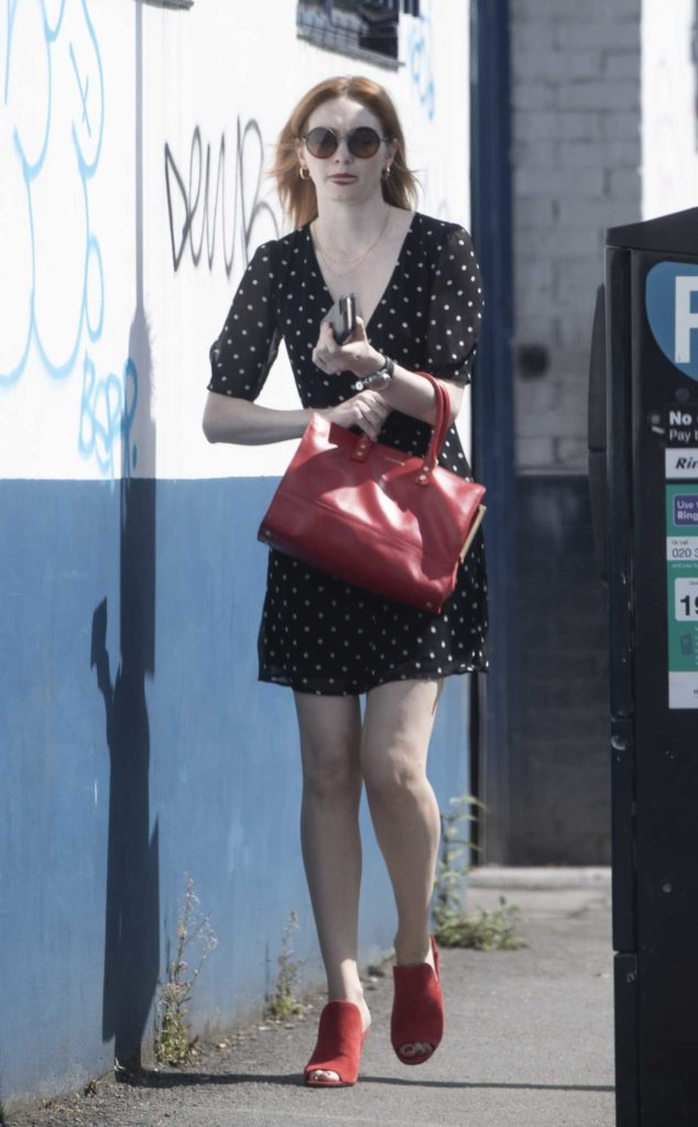Eleanor Tomlinson in a Black Polka Dot Dress