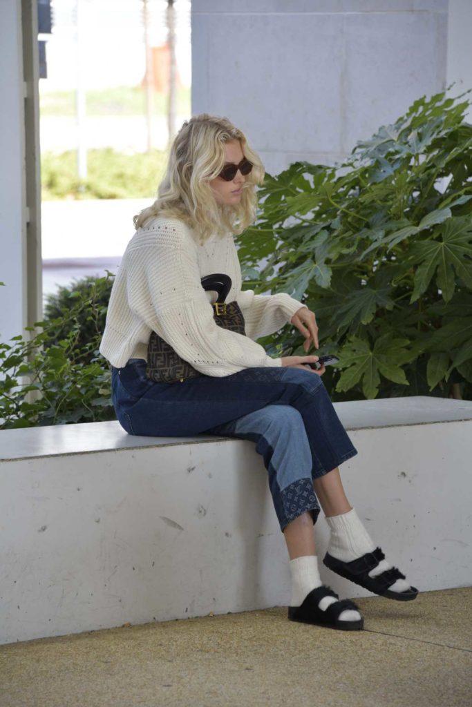 Elsa Hosk in a Beige Sweater