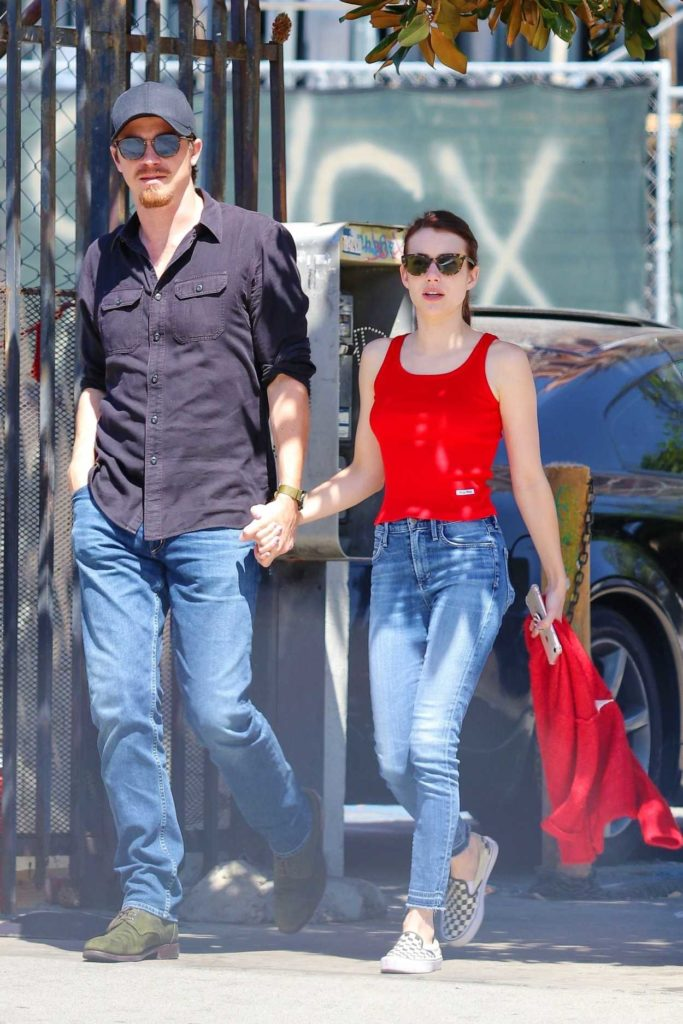Emma Roberts in a Red Tank Top
