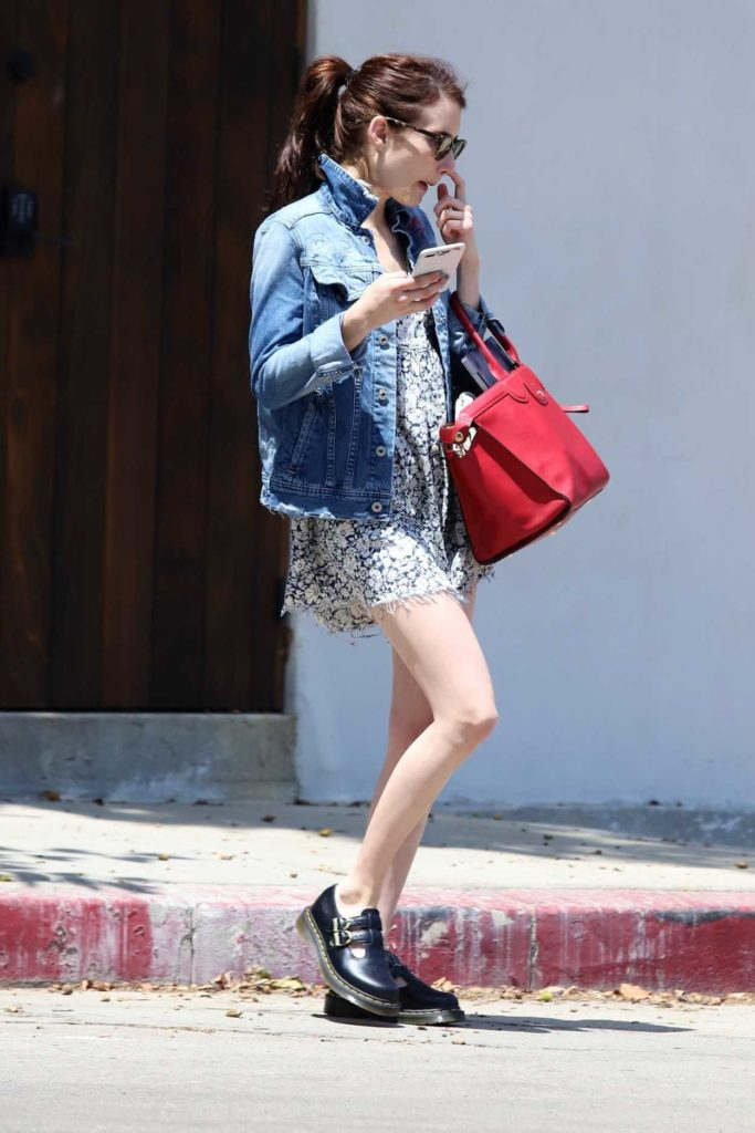 Emma Roberts in a Short Gray Floral Dress