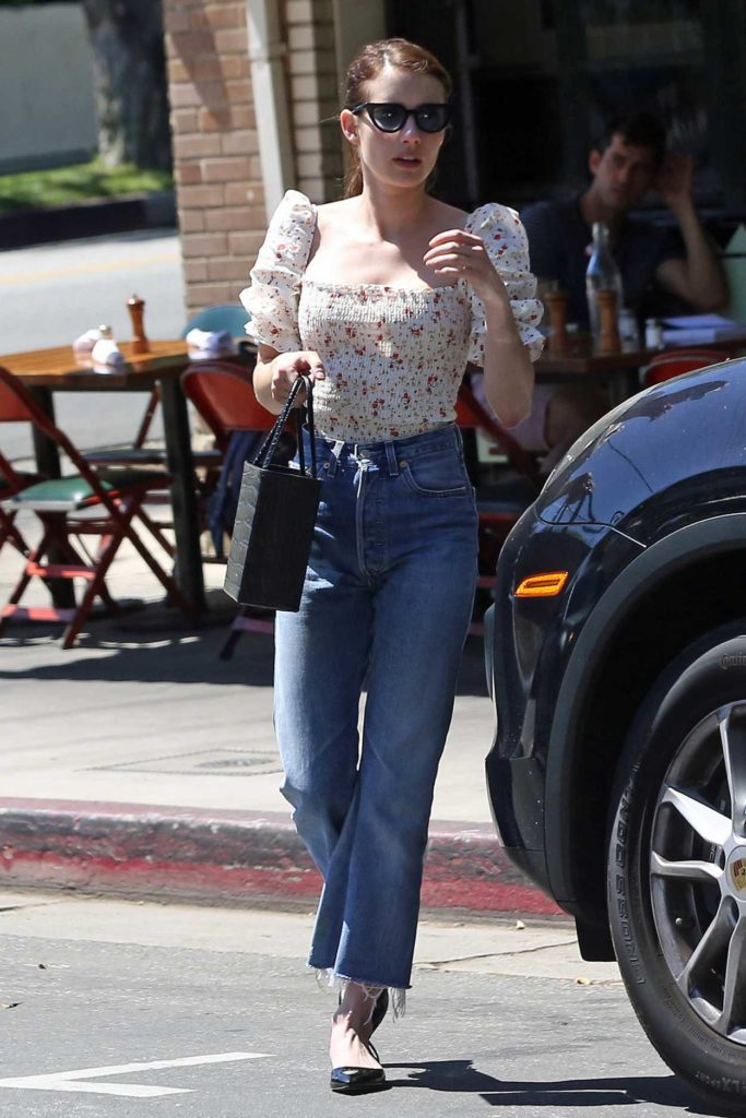 Emma Roberts in a White Floral Blouse