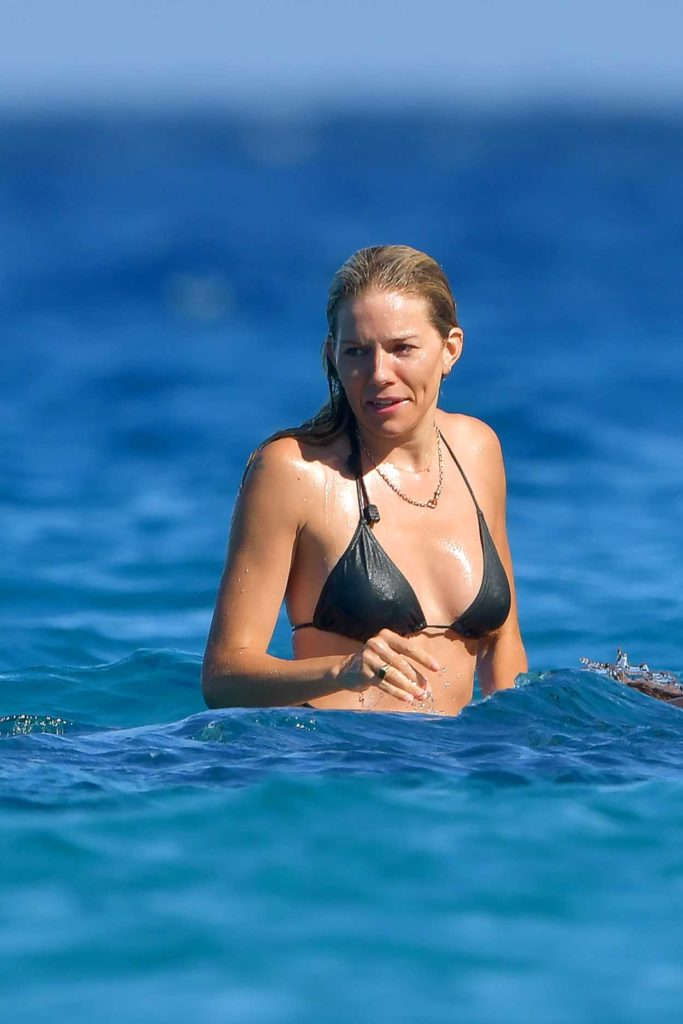 Sienna Miller in a Black Bikini