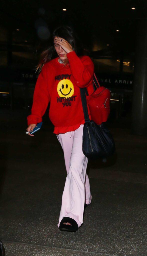 Bella Thorne in a Red Sweater