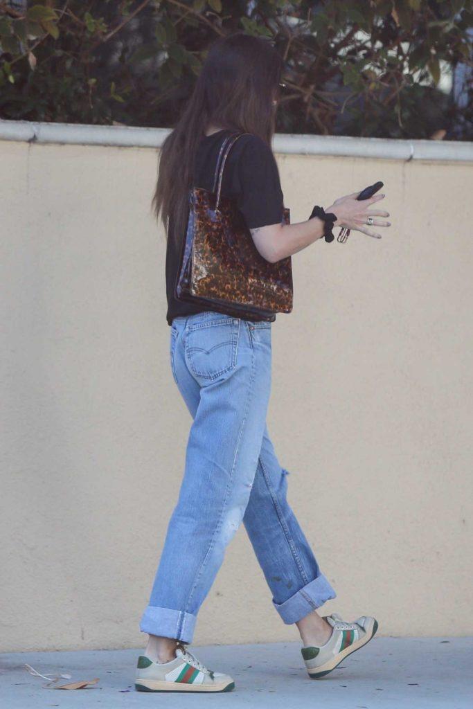 Dakota Johnson in a Gucci Sneakers