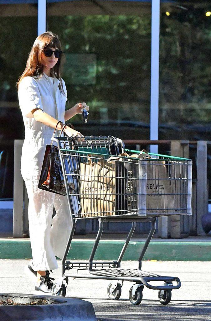 Dakota Johnson in a White Jumpsuit