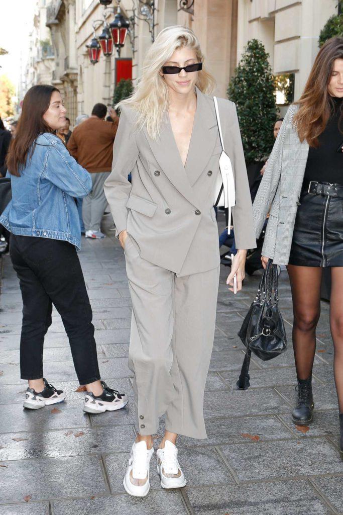Devon Windsor in a Gray Suit