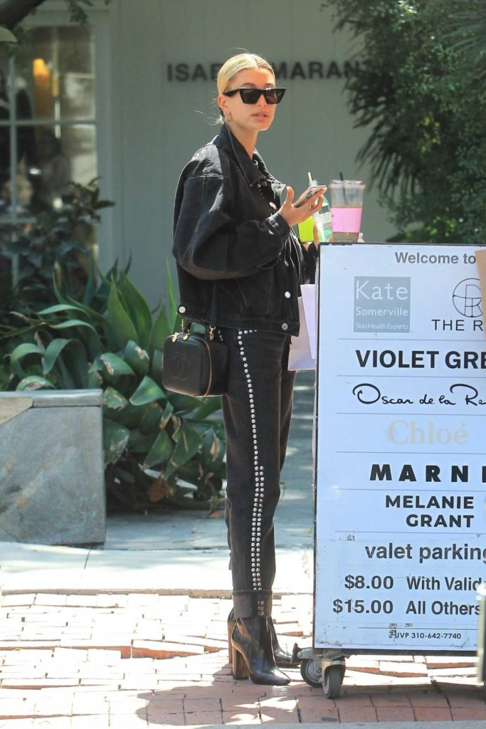 Hailey Baldwin in a Black Denim Jacket