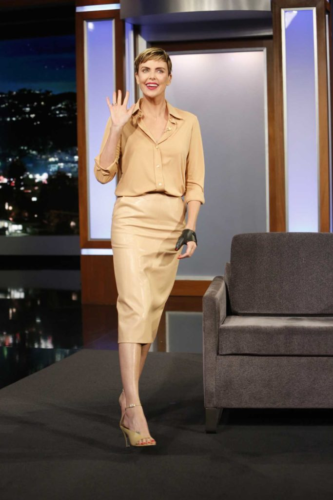 Charlize Theron in a Beige Suit