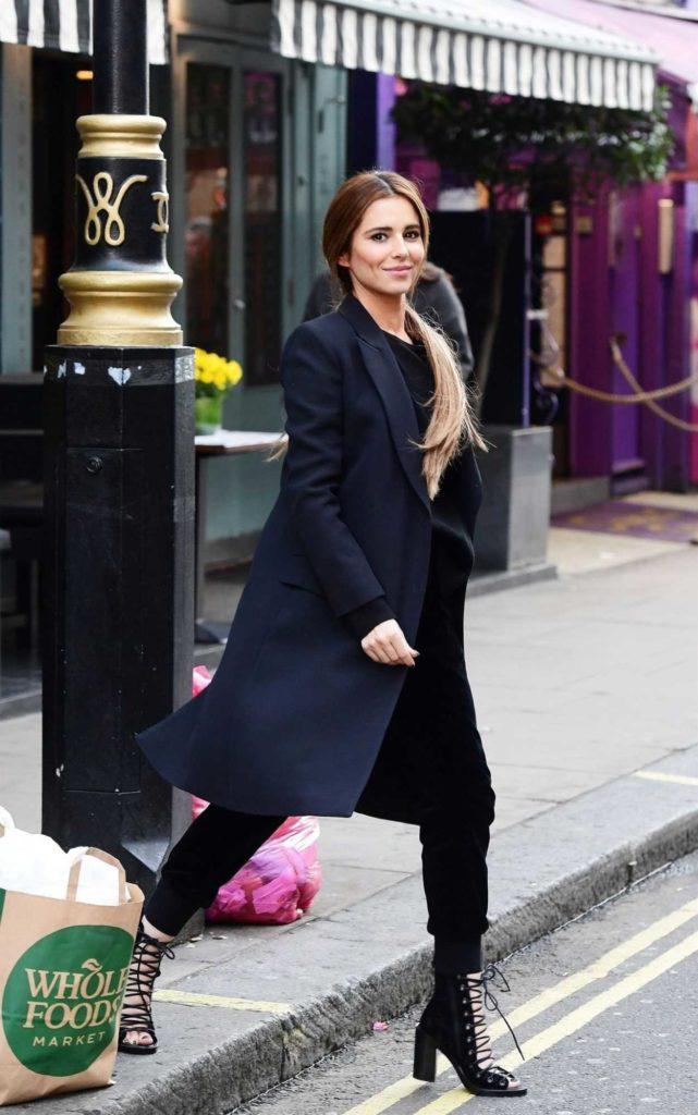 Cheryl Tweedy in a Black Coat