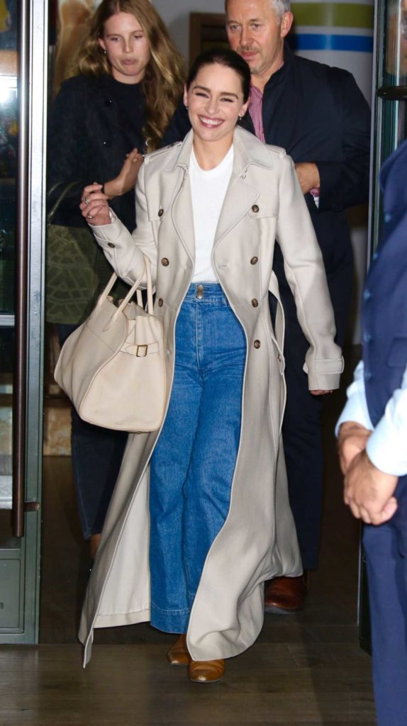 Emilia Clarke in a Beige Coat