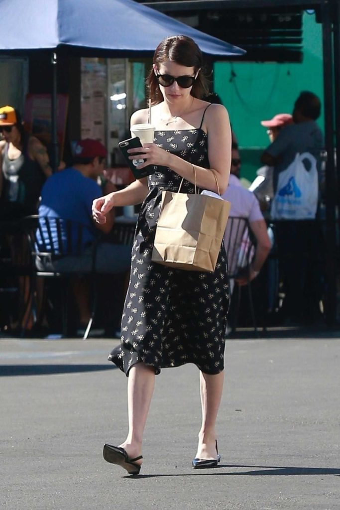 Emma Roberts in a Black Floral Sundress