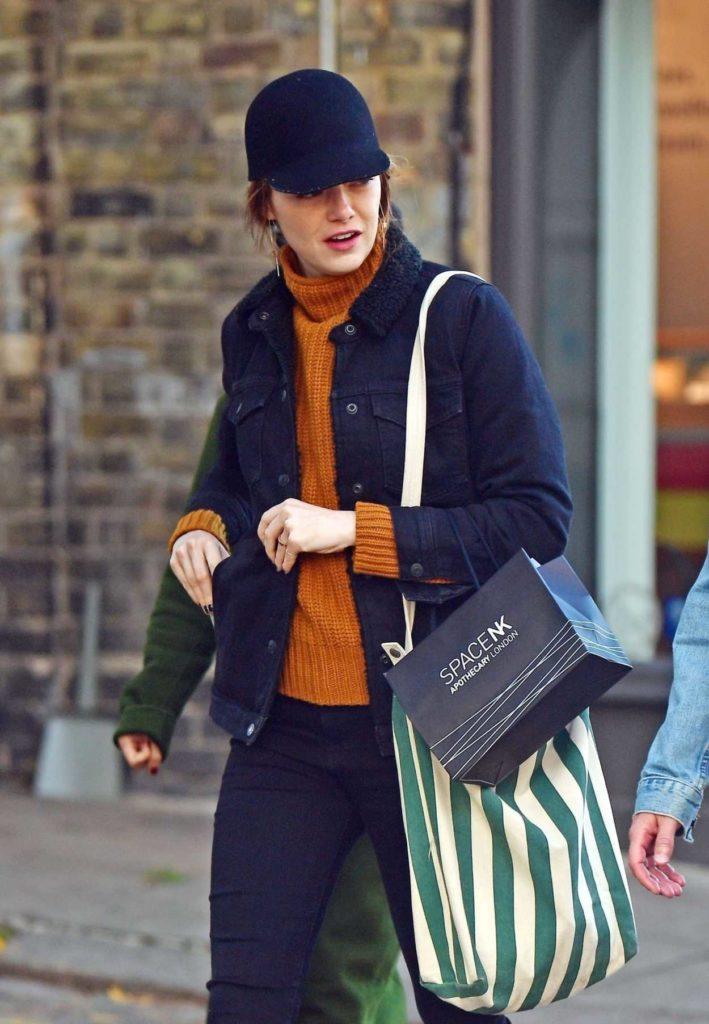Emma Stone in a Black Cap