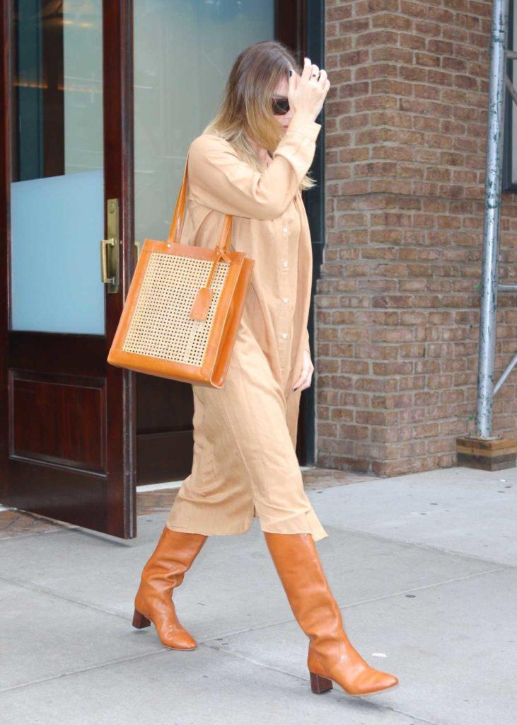 Margot Robbie in a Beige Dress