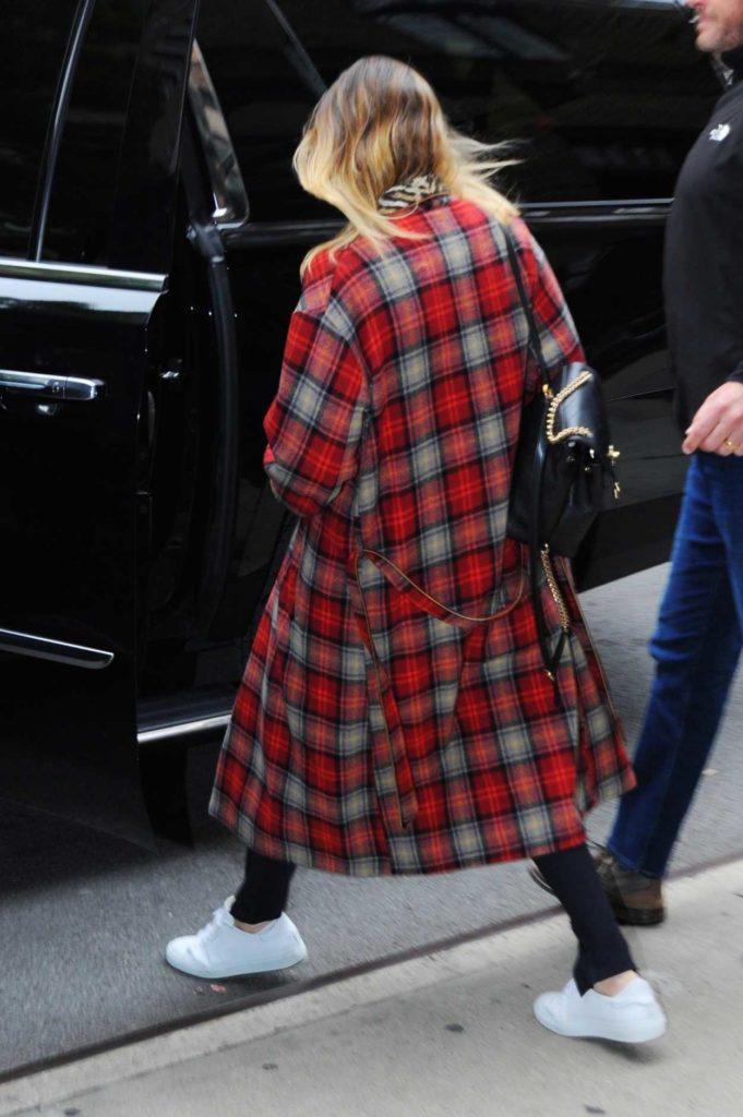 Margot Robbie in a Plaid Coat