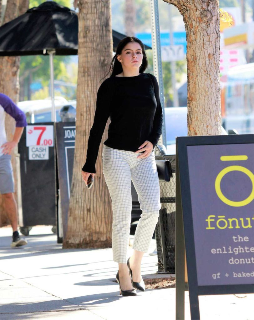 Ariel Winter in Black Sweater