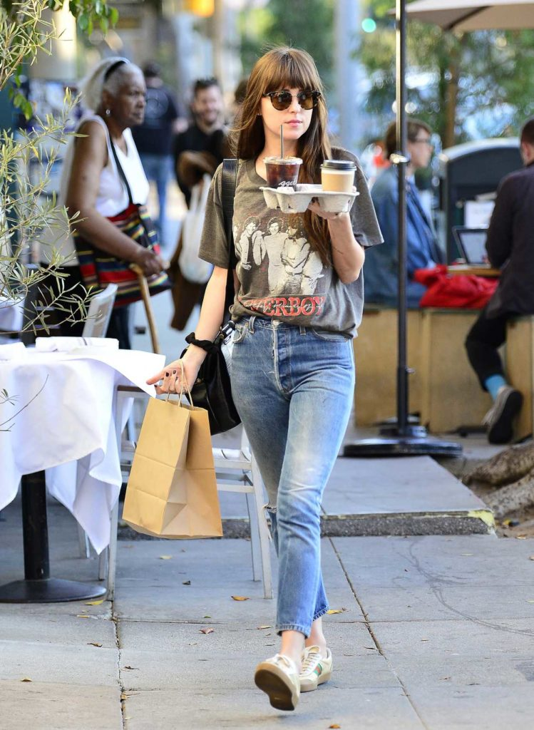 Dakota Johnson in a Blue Ripped Jeans
