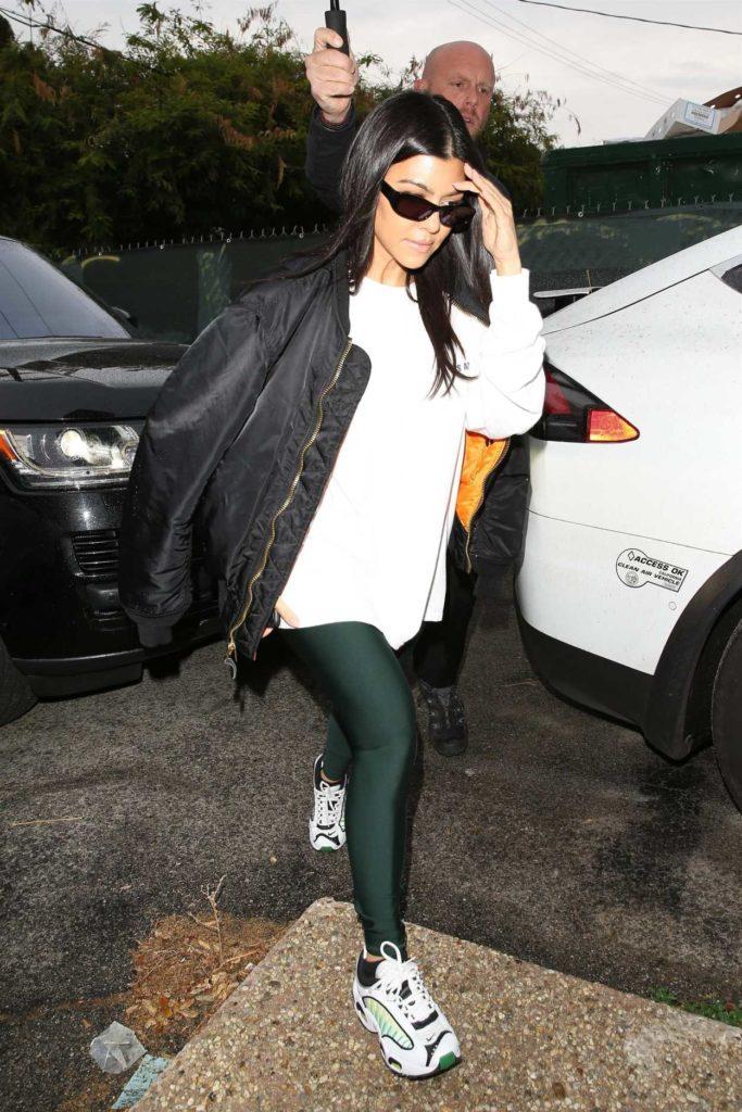 Kourtney Kardashian in a Black Bomber Jacket