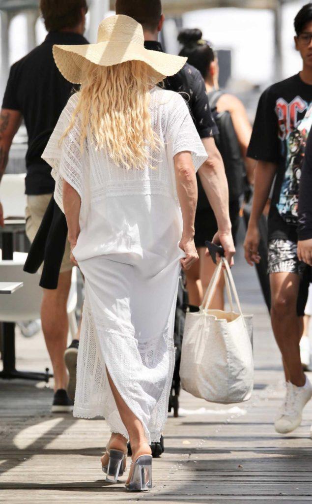 Pamela Anderson in a Beige Hat