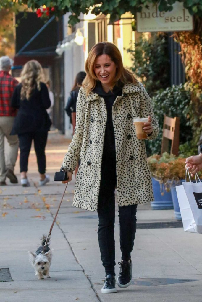 Ashley Tisdale in a White Leopard Print Fur Coat
