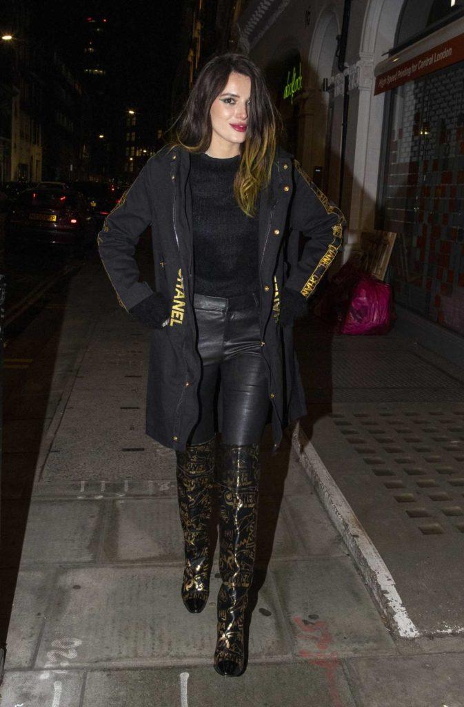 Bella Thorne in a Black Coat