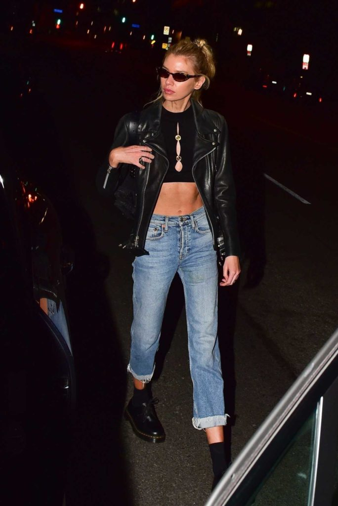 Stella Maxwell in a Black Leather Jacket