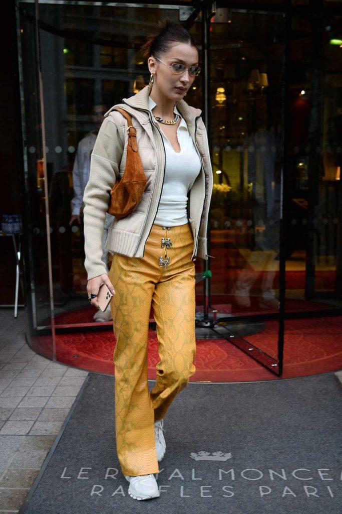 Bella Hadid in a Yellow Snakeskin Print Pants