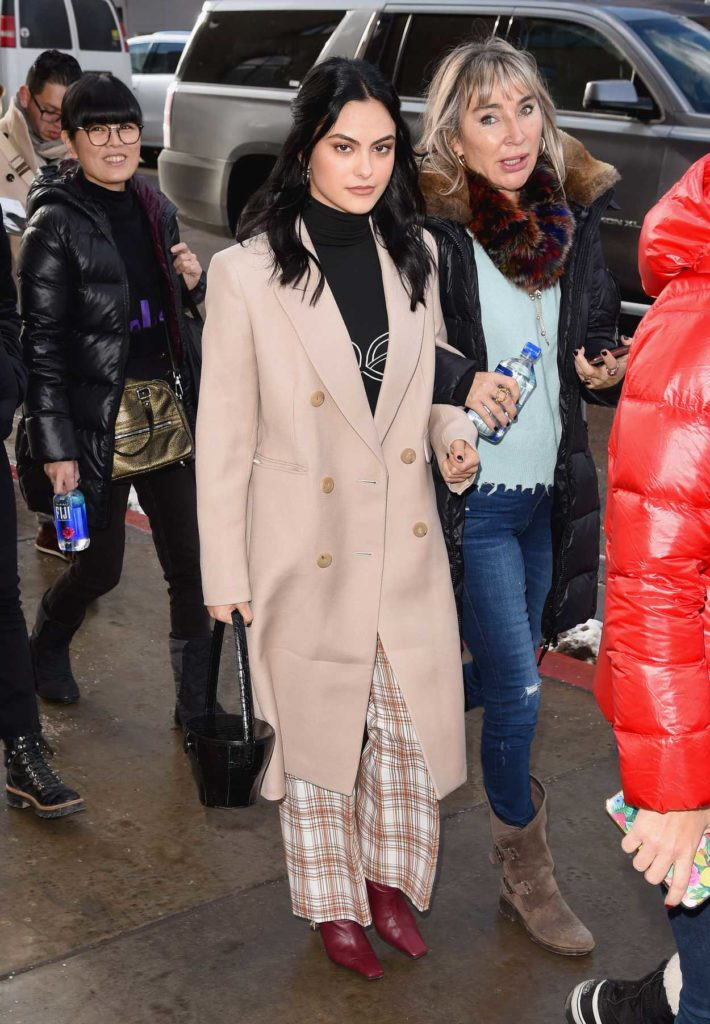 Camila Mendes in a Beige Coat