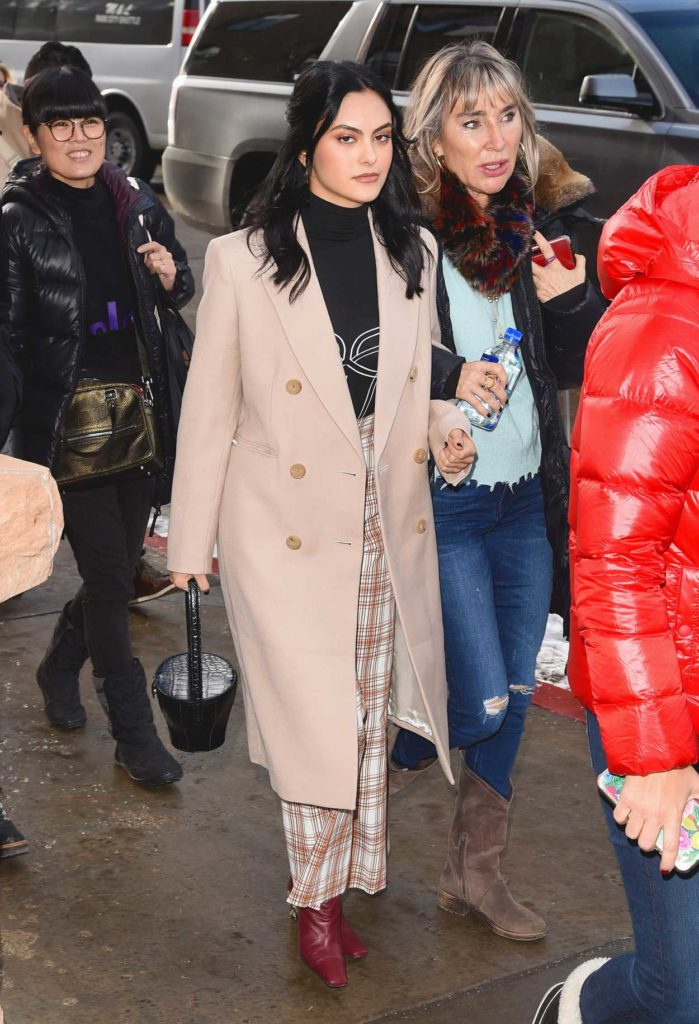 Camila Mendes in a Beige Coat