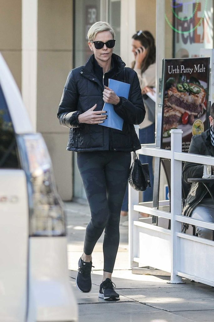 Charlize Theron in a Black Sneakers