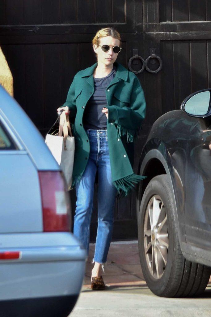 Emma Roberts in a Green Coat