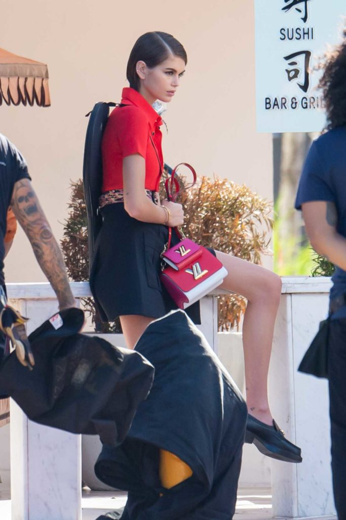 Kaia Gerber in a Red Blouse