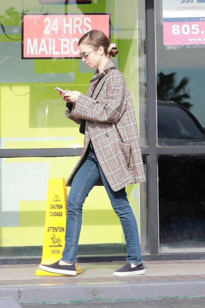 Lily Collins in a Plaid Blazer
