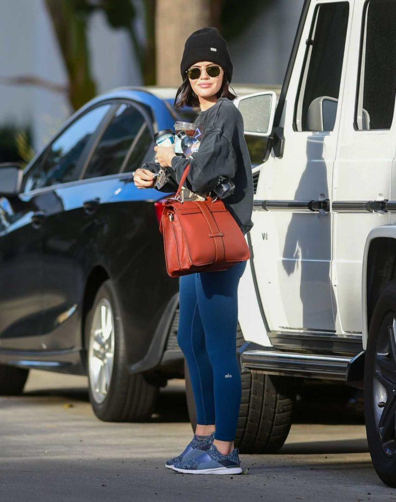Lucy Hale in a Blue Leggings