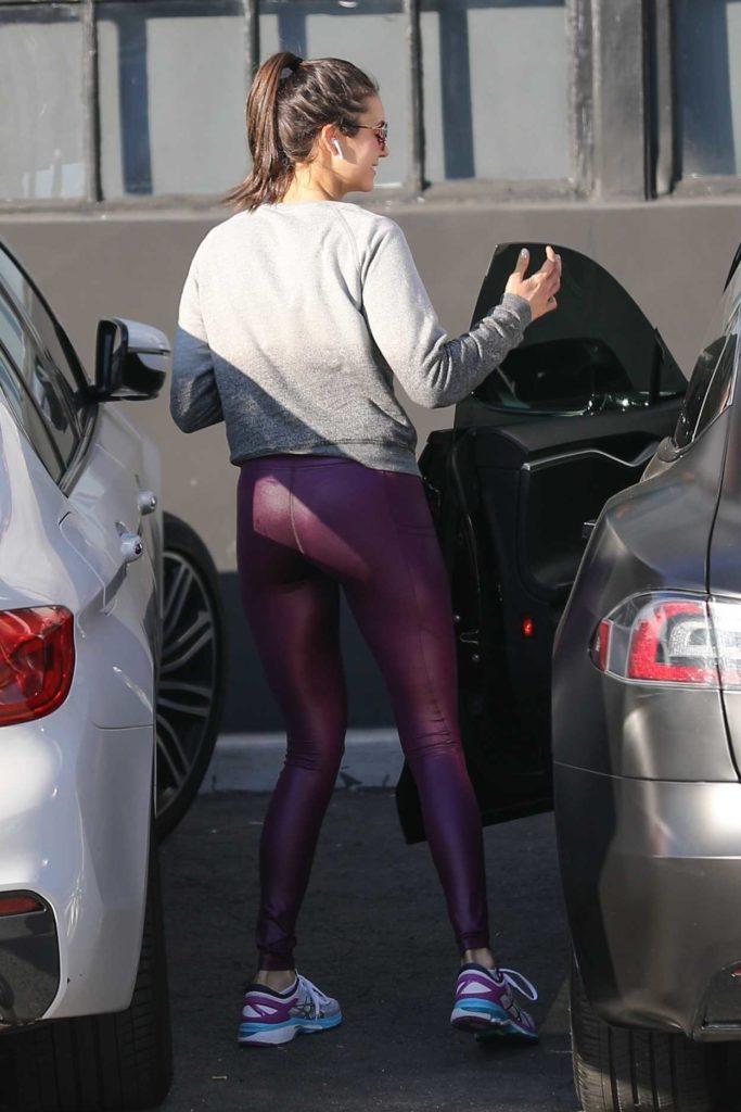 Nina Dobrev in a Purple Leggings