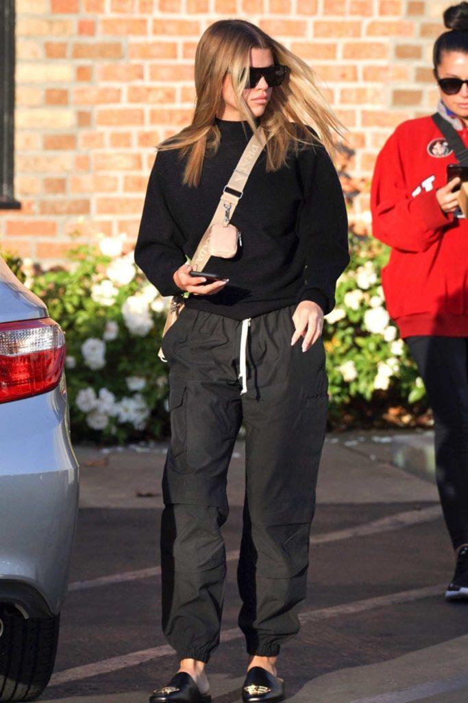 Sofia Richie in a Black Sweater