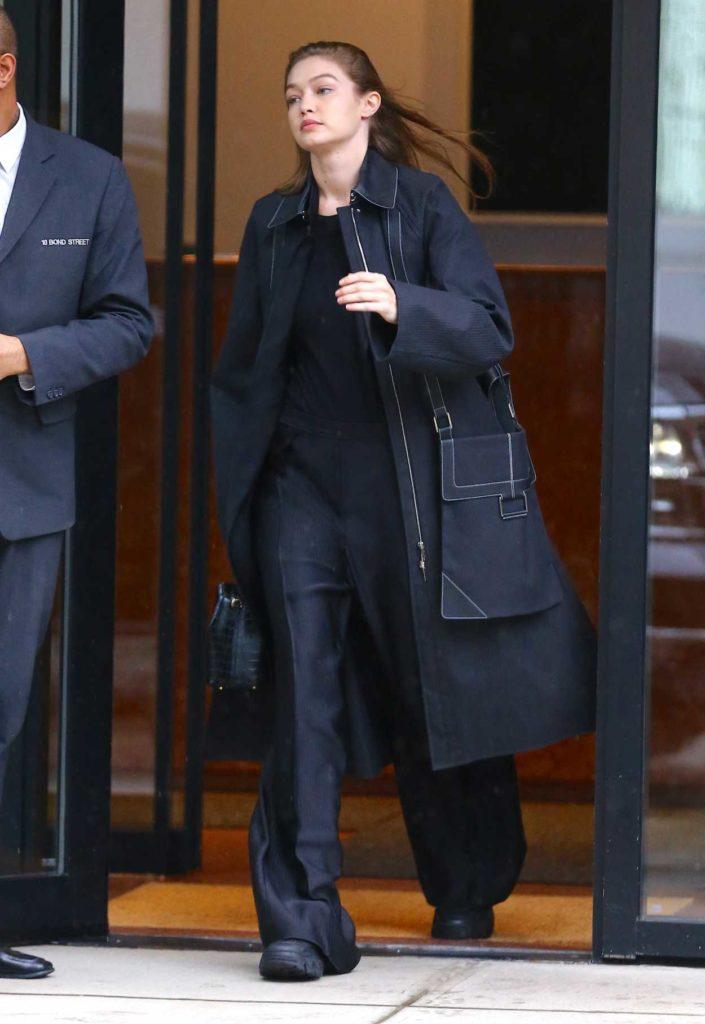 Gigi Hadid in a Black Trench Coat