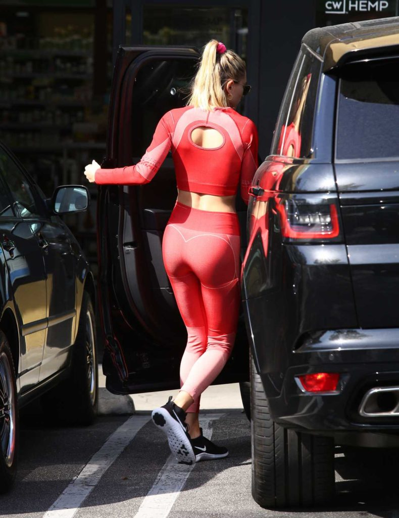 Hailey Bieber in a Red Leggings