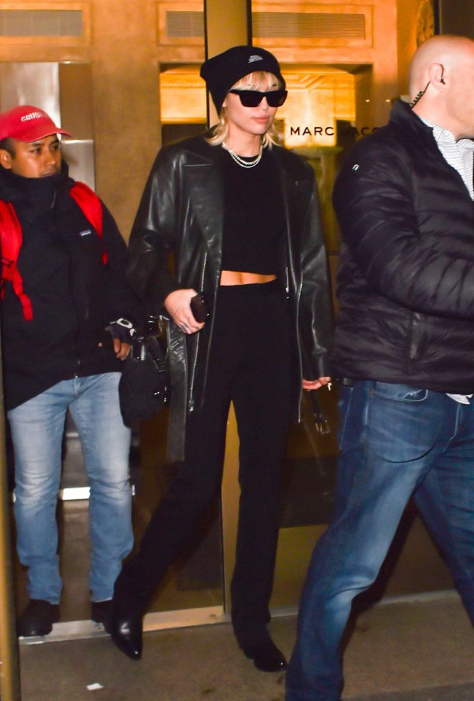 Miley Cyrus in a Black Knit Hat