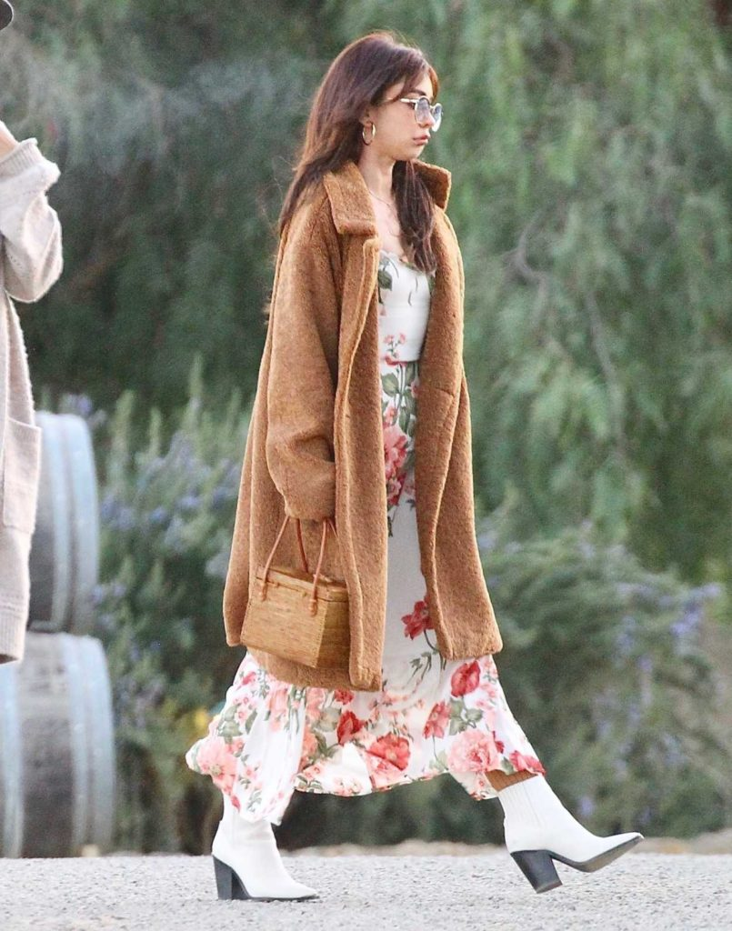 Sarah Hyland in a Beige Fur Coat