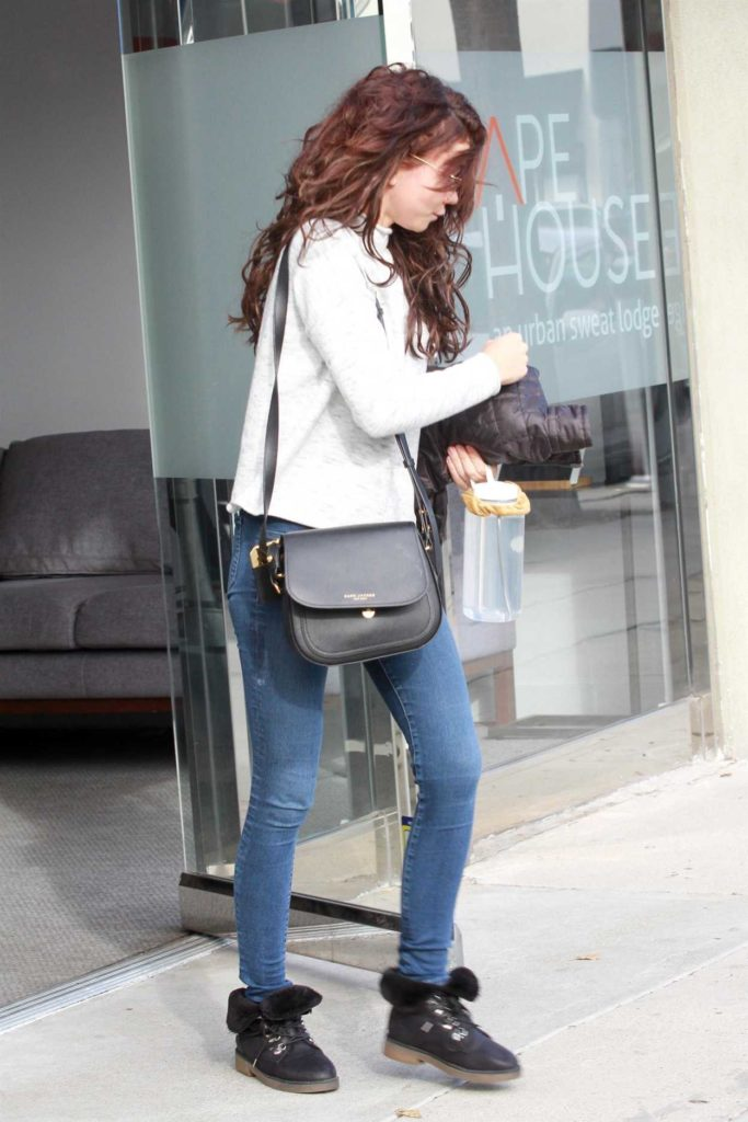 Sarah Hyland in a Black Boots