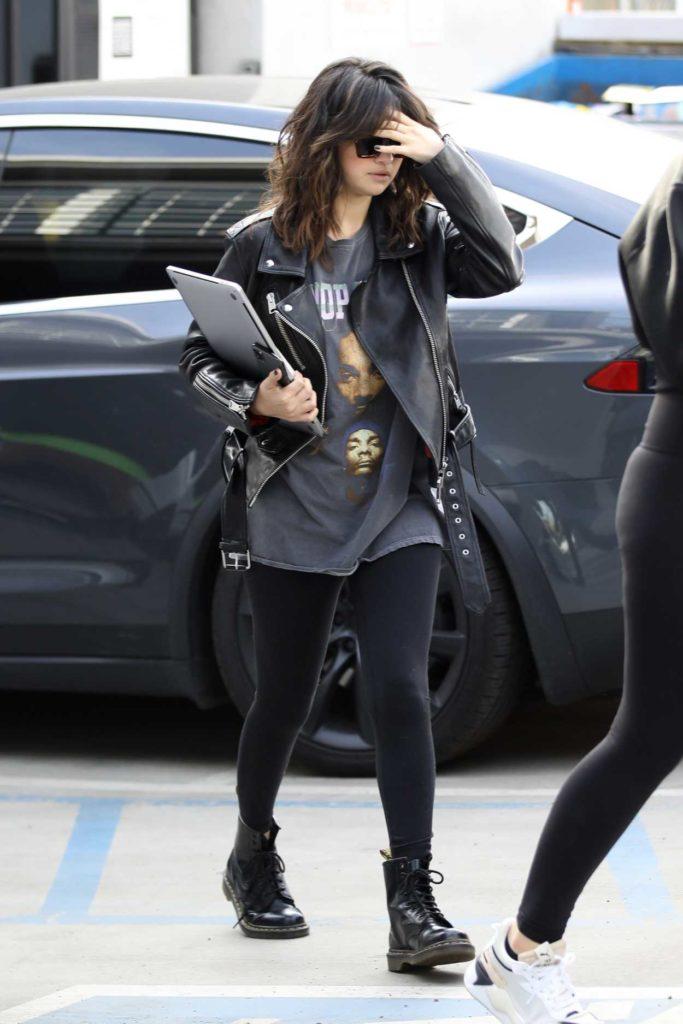 Selena Gomez in a Black Boots
