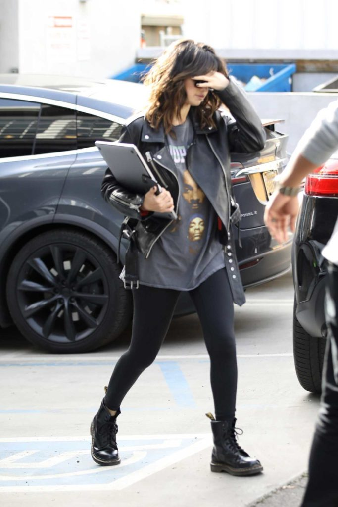 Selena Gomez in a Black Boots