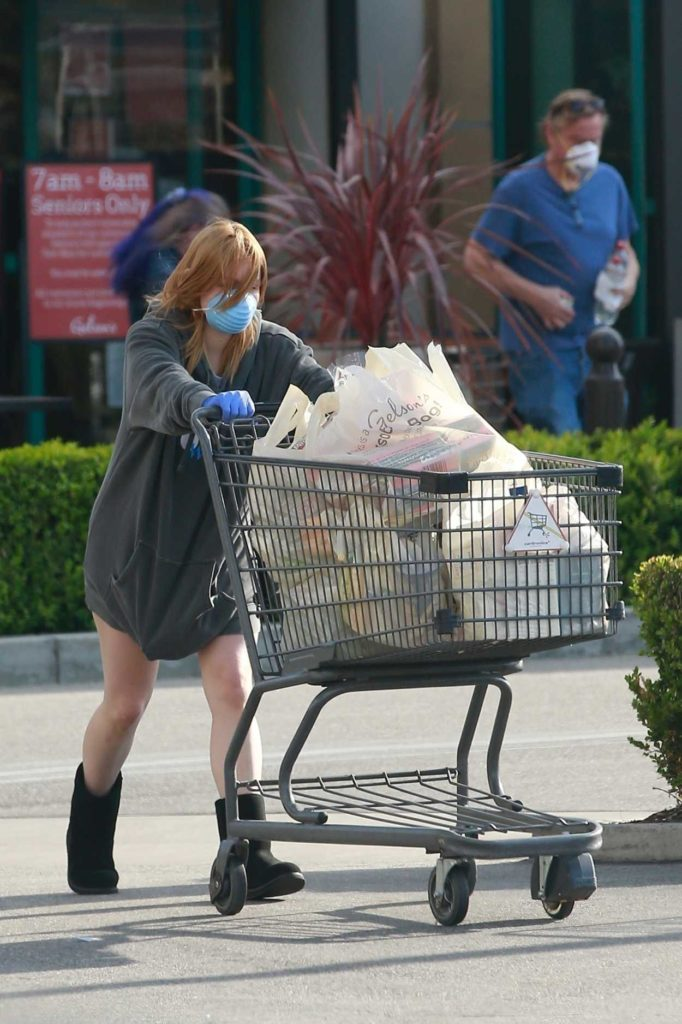 Ariel Winter in a Blue Surgical Face Mask