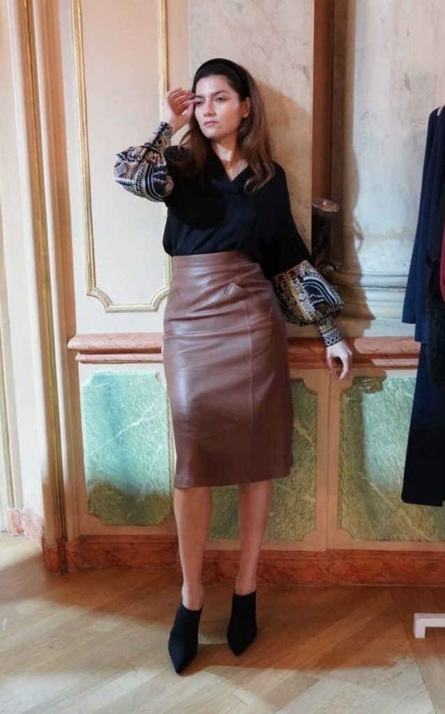 Blanca Blanco in a Brown Leather Skirt