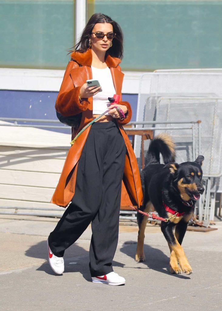 Emily Ratajkowski in an Orange Leather Coat