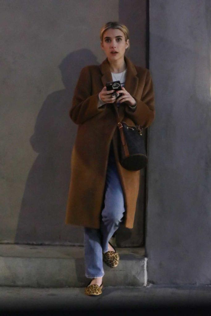 Emma Roberts in a Tan Coat