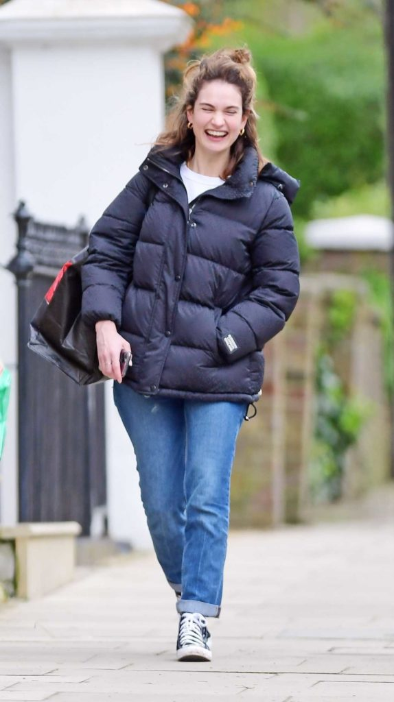 Lily James in a Black Puffer Jacket