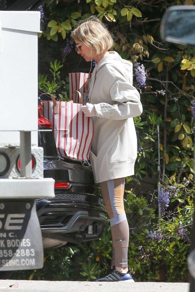 Naomi Watts in a Beige Hoody